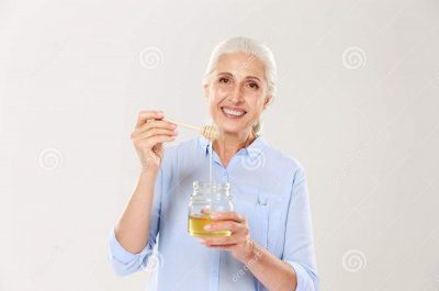 close-up-portrait-smiling-old-woman-holding-honey-jar-s-close-up-portrait-smiling-old-woman-holding-honey-jar-103006179.jpg