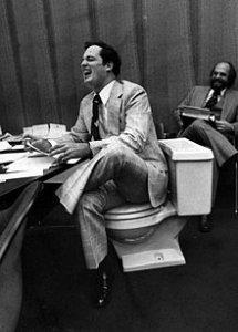 220px-Senator_Robert_McKnight_sits_on_a_toilet_seat_dnd0276.jpg